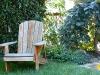 Peaceful backyard with small sandbox